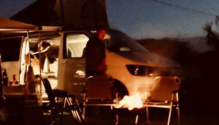 Fire Pit and Grill at night in front of Campervan hire